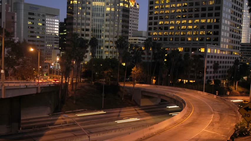 Traffic moves in time lapse along a freeway in downtown Los Angeles. | Shutterstock HD Video #1631470