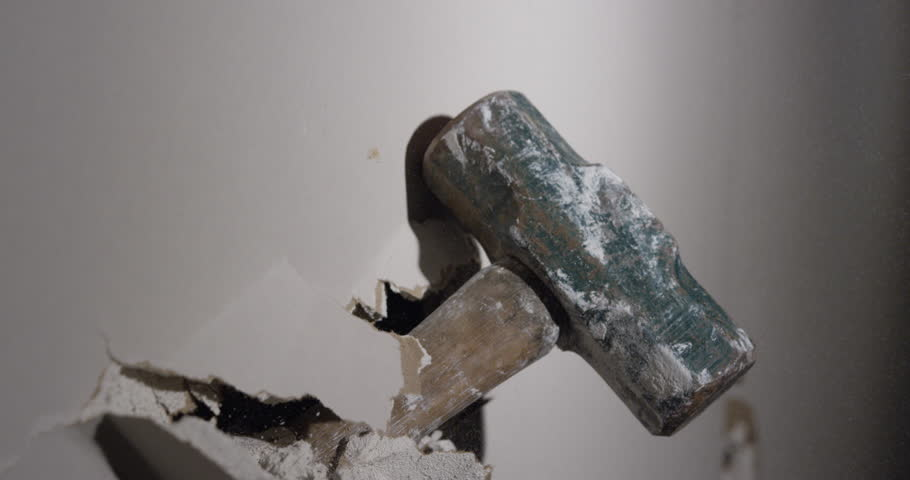 Smashing through drywall in slow motion iron fist punch