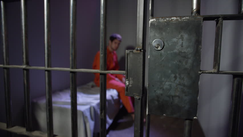 Prison cell door opens to release caucasian inmate