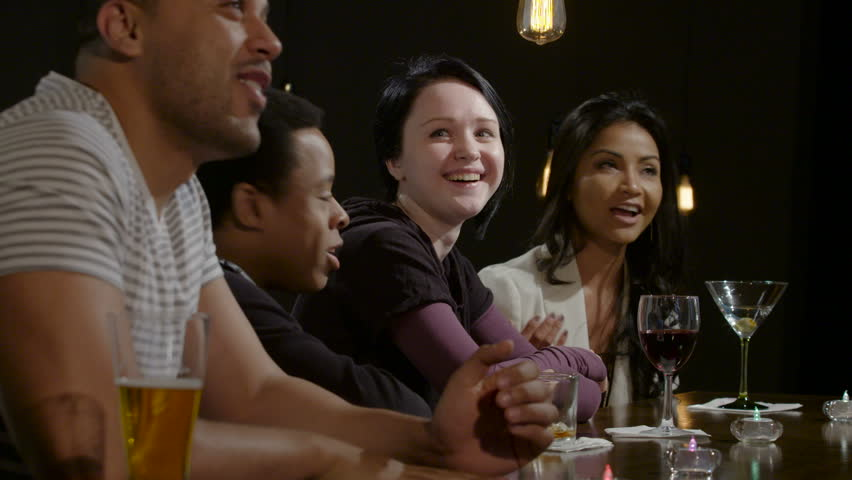 Friends drinking and cheering at a bar | Shutterstock HD Video #16330954