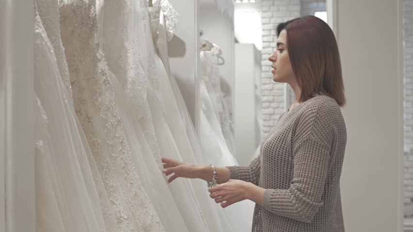 Women having fun during bridal gown fitting in wedding fashion store | Shutterstock HD Video #16345624