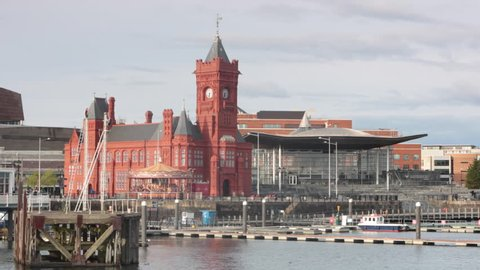 Cardiff bay development and pierhead building in Cardiff with the National Assembly for Wales at sunset