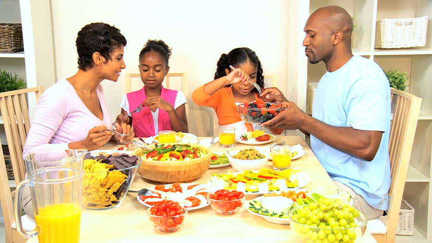 Young African American Family Sharing A Healthy Lunch -2904