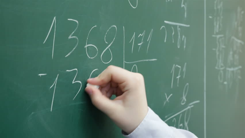 A pupil solves math on the chalkboard at primary school, Close up, Full HD shot