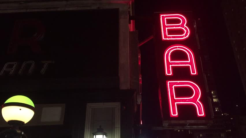 New York City Nighttime NX Establishing Shot CV of Bar Pub. Night exterior video footage of vintage neon sign. New York people go out at night to have fun, drink alcohol, go out on date, get together #16444246
