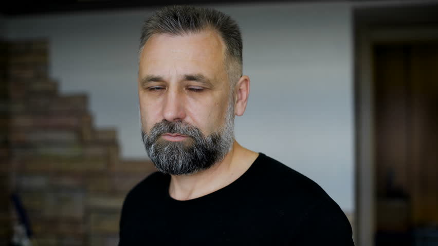Client. Man aged with graying hair. Evaluates haircut beard and hairstyle.  | Shutterstock HD Video #16481602
