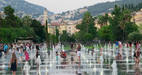 Nice France 14 July 2015: Massena Place square fountains view. Nizza city travel, tourism, cityscape. Famous French riviera promenade, Europe.  Water attractions, summer. Bastille day. Old town park