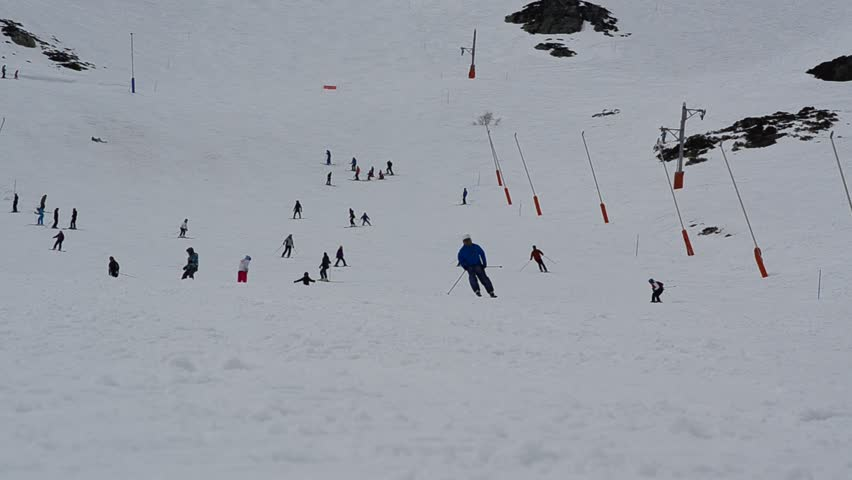 SAN ISIDRO, LEON, SPAIN - MARCH 2016 - Skiers and snowboarders in a ski resort in Spain