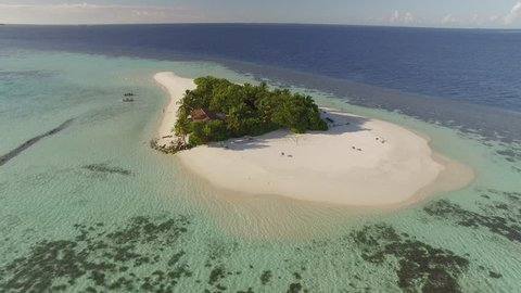 Aerial shot of a small tropical island in Maldives island, 2015.