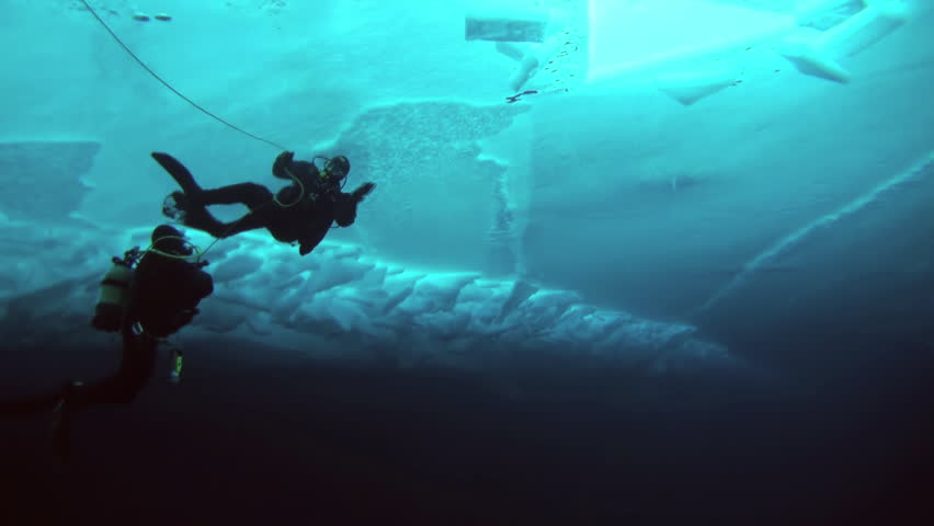 Unique extreme underwater shooting scuba dive beneath ice at geographic  North Pole in cold waters. Fantastic views of the lump of ice in water. ICE CAMP BARNEO, NORTH POLE, ARCTIC - APRIL 10, 2015 | Shutterstock HD Video #16516648