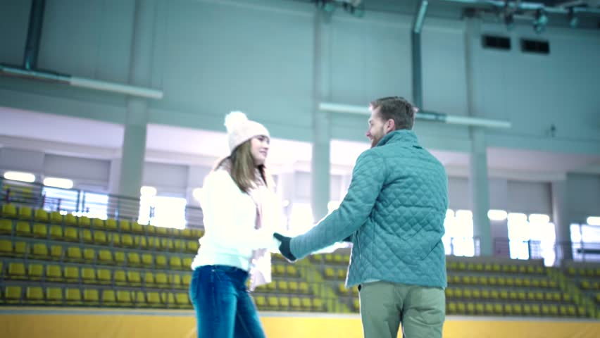 Smiling young couple at skating rink   Shutterstock HD Video #16520704