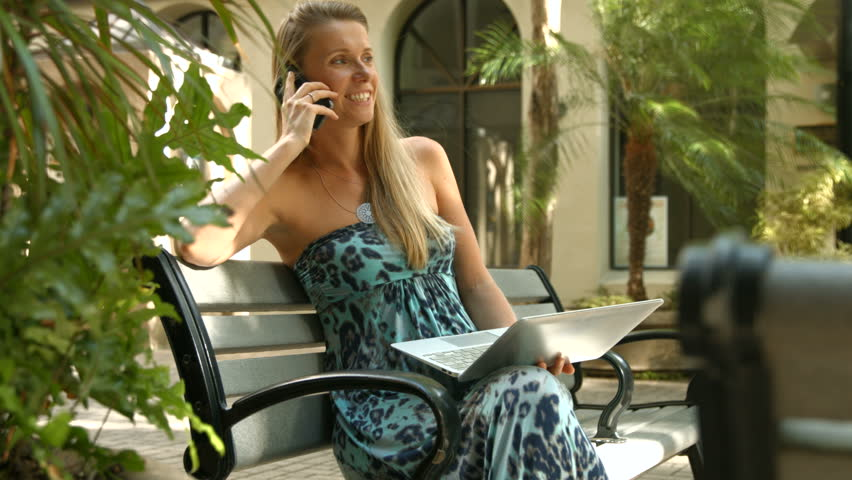 4k young beautiful woman reading ebook sitting on bench in city 4k woman with laptop and mobile phone sitting on the bench pretty happy woman fandeluxe Ebook collections