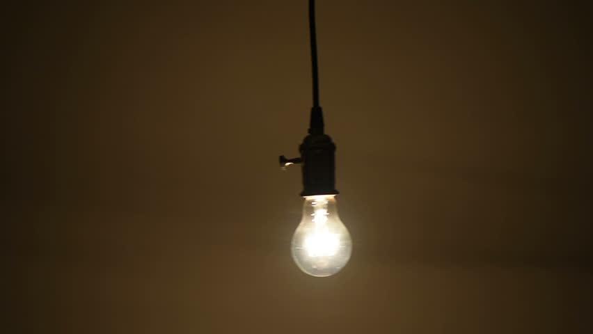 Swinging lightbulb tv