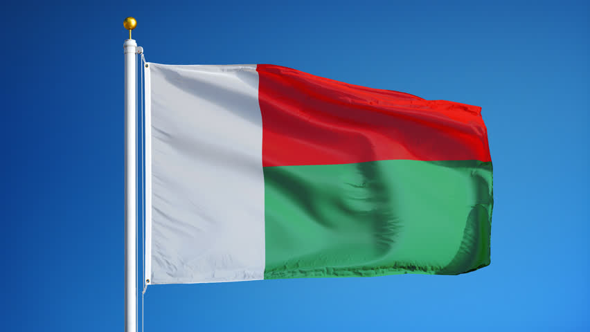 Madagascar Flag Waving In Slow Motion Against Clean Blue Sky - Madagascar flag