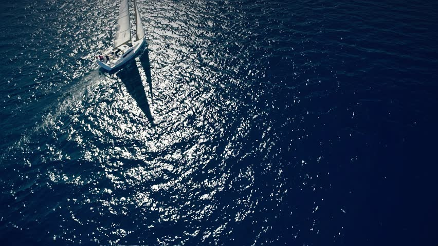 Yacht sailing on opened sea. Sailing boat. Yacht from drone. Yachting video. Yacht from above. Sailboat from drone. Sailing video. Yachting at windy day. Yacht. Sailboat. | Shutterstock HD Video #16596541