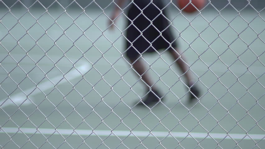 A young man playing basketball on a rainy day. - Super Slow Motion - Model Released - 1920x1080 - Full HD - filmed at 240 fps