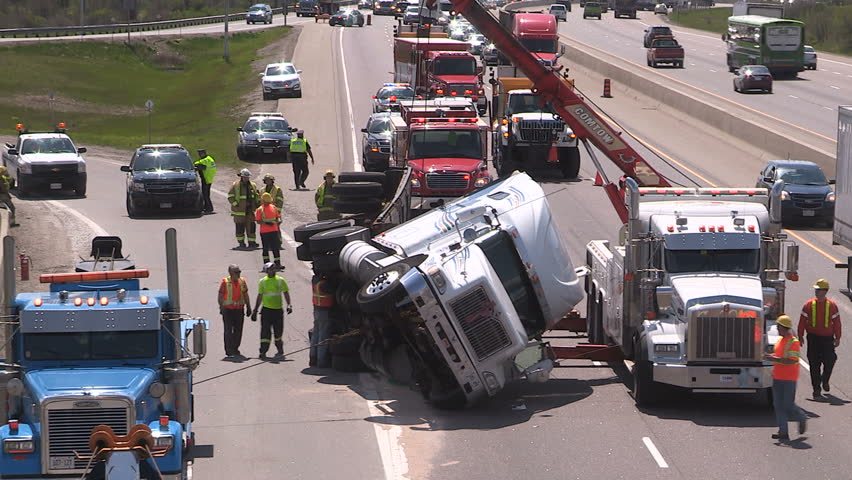 Guelph, Ontario, Canada May 2016 Tractor trailer truck crash on highway with police and firefighters at scene