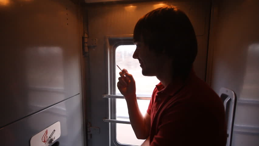 man smokes in a passenger train in place for smoking