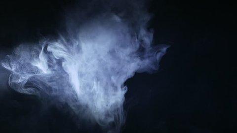 Smoke on a dark background. Vaping. 4K UHD