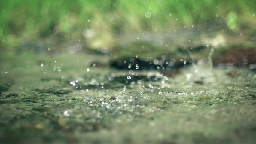 Slow motion closeup of spring water and drops | Shutterstock HD Video #16683991