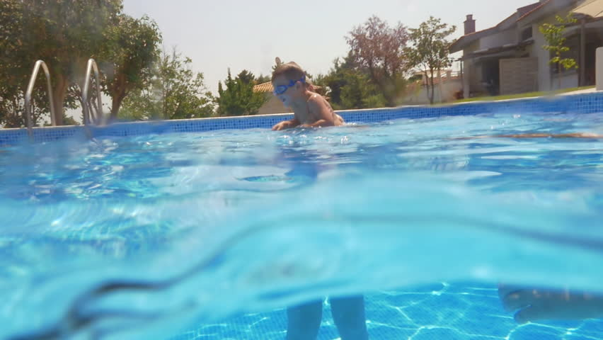 Businessman Lying On Lilo In Swimming Pool While Drinking A Beer Stock Footage Video 14185655