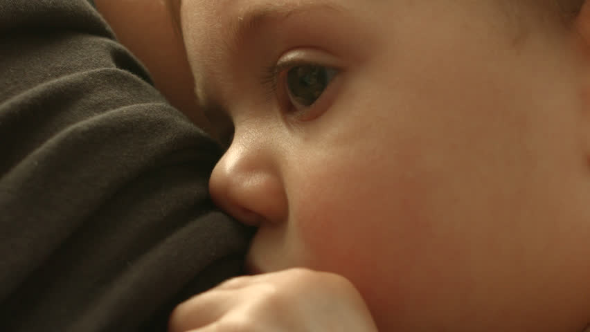 A baby breastfeeding from her mother, close up, drinking milk in slow motion | Shutterstock HD Video #16730158