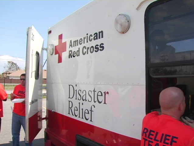 An American Red Cross discusses strategy with a Katrina volunteer.