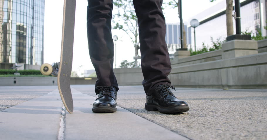 Close view of young man's smart shoes as stands with a skateboard on the pavement in Downtown Los Angeles.  Slow motion recorded at 60fps. | Shutterstock HD Video #16745944