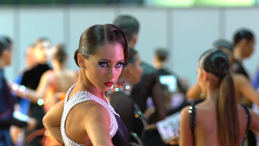 MOSCOW, RUSSIA - MAY 09, 2016: Beautiful girl with artistic makeup dancing in the ballroom. Close-up, slow motion. XIII world Dance Olympiad 2016.
