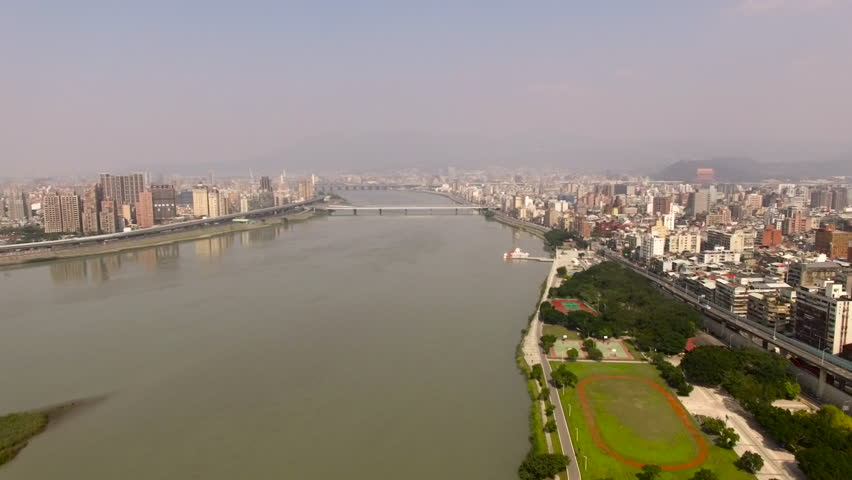 Taipei - 6 FEB: View of the city buildings and the Tamsui River on 6 February 2016 in Taipei, Taiwan | Shutterstock HD Video #16815364