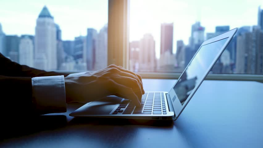 Working on laptop computer in modern office desk analyzing financial  profits progress. business charts diagrams background. online banking from home. city skyline window view  | Shutterstock HD Video #16830754