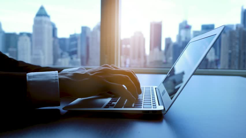 Working on laptop computer in modern office desk analyzing financial  profits progress. business charts diagrams background. online banking from home. city skyline window view  | Shutterstock HD Video #16830808