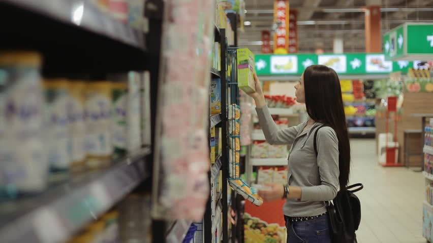 Young pretty girl shopping in a grocery store/supermarket