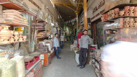 DUBAI, UAE - SEPTEMBER 14: Dubai Spice Souk  or the Old Souk is a traditional market  in Dubai, United Arab Emirates, selling a variety of fragrances and spices. timelapse hyperlapse