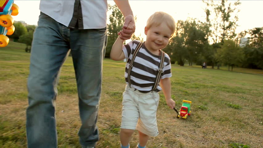 Father and little boy running with toy car (slow motion) | Shutterstock HD Video #1688230