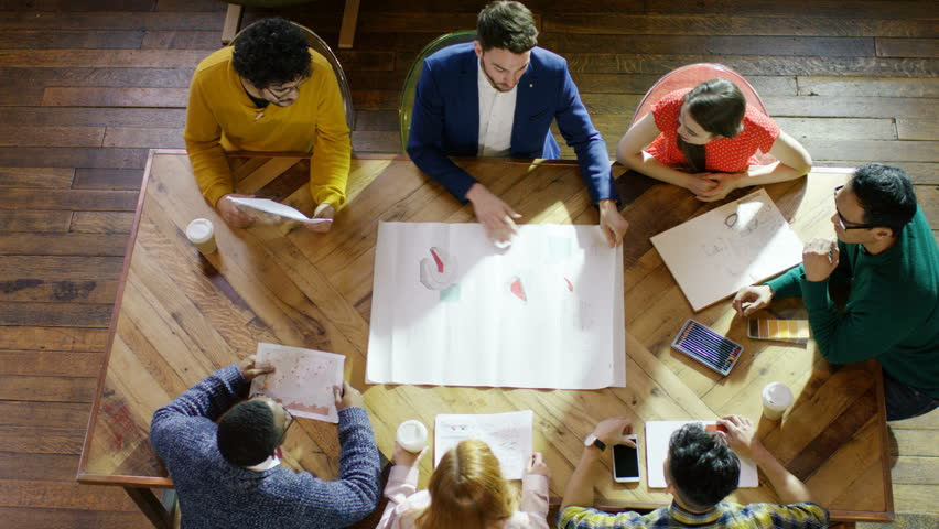 4K Overhead view of creative business team in a meeting. Shot on RED Epic. UK - April, 2016 | Shutterstock HD Video #16903834