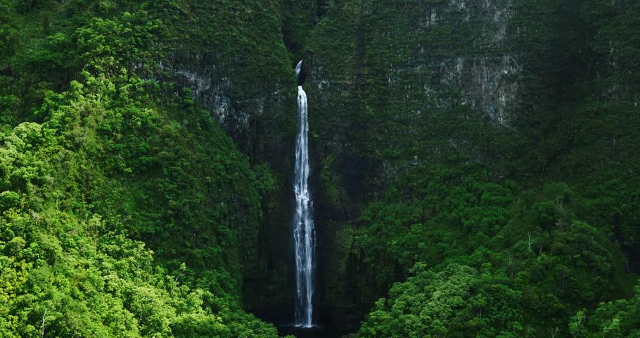 Aerial view of giant waterfall in tropical rain forest jungle. Hanakapiai Falls, Kauai   Shutterstock HD Video #16907194