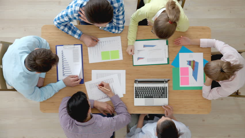 Diverse people working with financial reports and laptop   Shutterstock HD Video #16933144