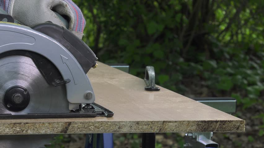 Cutting a panel with a circular saw | Shutterstock HD Video #16949314