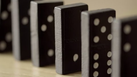 Dominoes falling against each other HD stock footage. Dominoes falling against each other in slow motion in true macro close up.