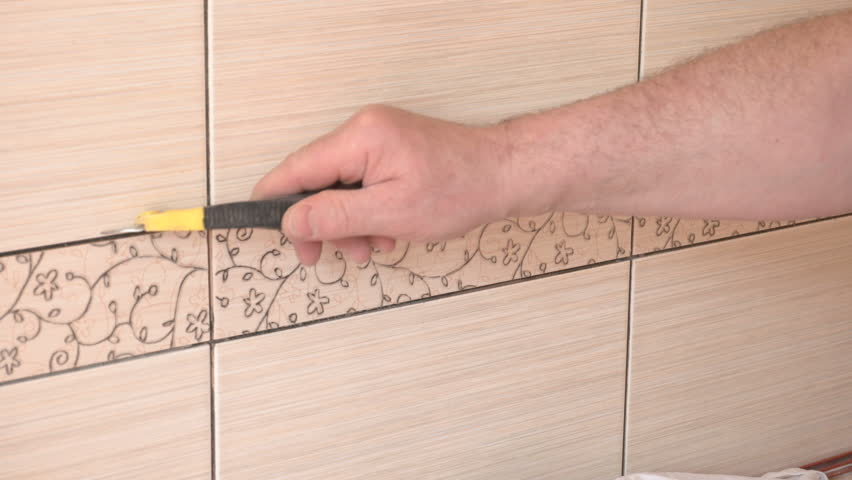 Stock video of man cleaning ceramic tiles. worker cleans | 16969174 ...
