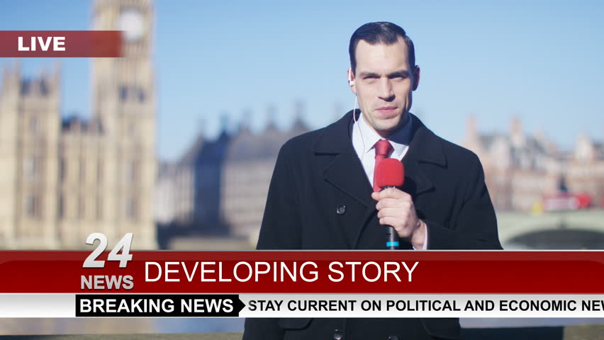 4K News reporter doing live piece to camera outdoors in the city of London UK - April, 2016