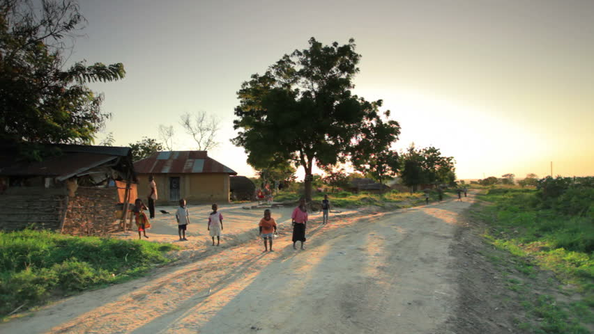 KENYA, AFRICA - CIRCA AUGUST 2010: Shot of children playing in the dirt roads in