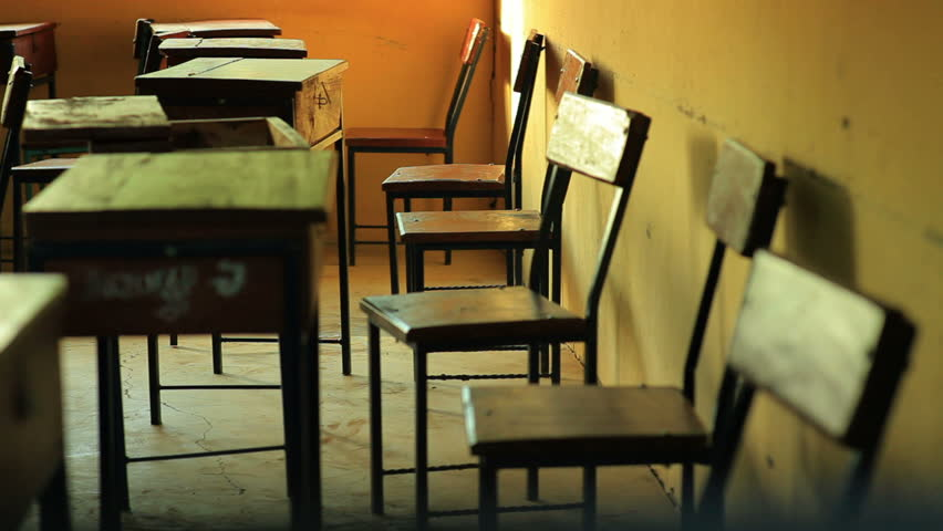 Empty students desks in a school in an African village, two hours north of Mombassa.