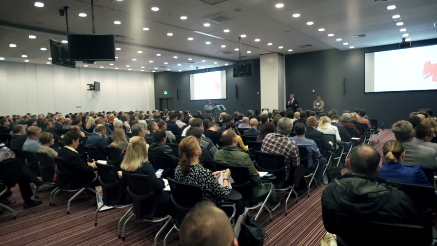 Novosibirsk Russia - May 31 2016: People on the forum on business development. The audience. Hall is full. Speaker in class says about business and finance. People raise their hands. | Shutterstock HD Video #17030986