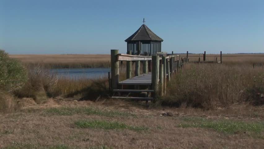 View of Kiosk on boat dock in marshland and lagoons in Wachapreague, Accomack county Eastern shore of Virginia, USA