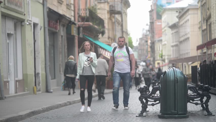 LVIV, UKRAINE - MAY 02, 2016: Couple tourists walking through the old streets of Lvov Lviv - spring day #17092744