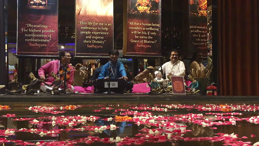 DELHI, INDIA - MAY, 2016: Hindu spiritual music performers in the transit area of Delhi International airport on May, 2016.   Shutterstock HD Video #17102674