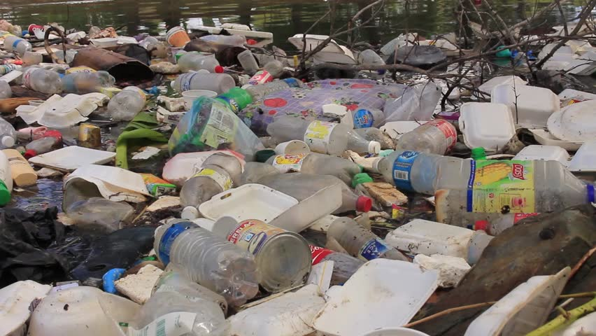 KOTA KINABALU, MALAYSIA - 05 JUNE 2016: Plastic bottles and bags pollution in the ocean.