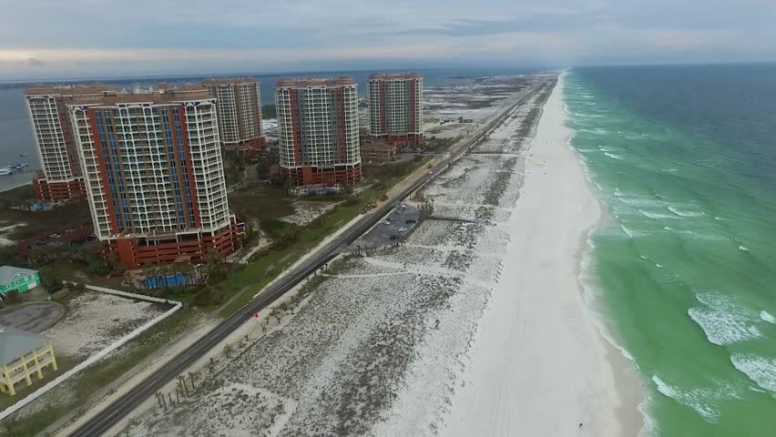 Pensacola Florida April 13 2016 Gulf Of Mexico And Portofino Island Resort Buildings With Sandy Beach In Stock Footage Video